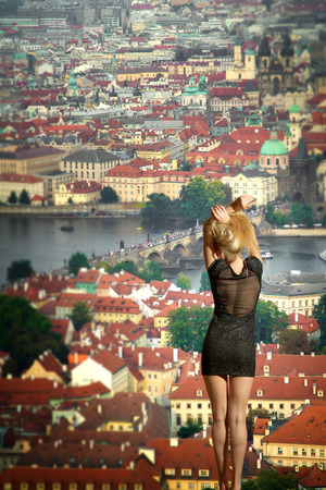 ass christmas: Woman enjoys the view of Europe. Most mystical and mysterious city in Europe. Prague through the eyes of birds Stock Photo