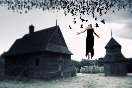 Witch floating in the air. picture in the style of a horror movie. photo