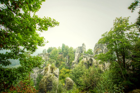 saxon: Bridge named Bastei in Saxon Switzerland Germany on a sunny day in autumn with colored trees and leafs