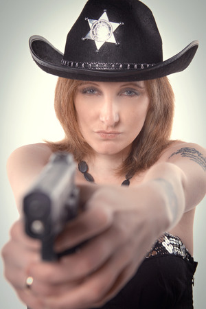 role models: girl with tattoos sheriff policeman in the studio. Stock Photo