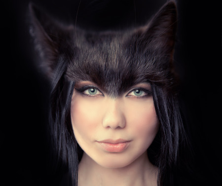 cat woman. Werewolf symbiosis of man and cat. The hidden nature of women walking alone. a symbol of independence. Passion and sexuality, danger and desire. photo