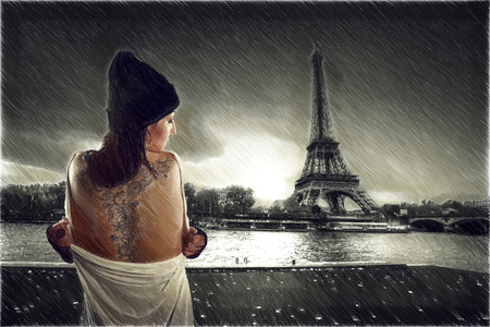 seine: girl with a tattoo stands on the banks of the Seine near the Eiffel Tower. dramatic portrait