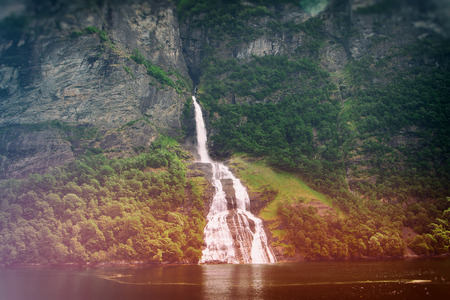 waterfalls northern Norwegian fjords.