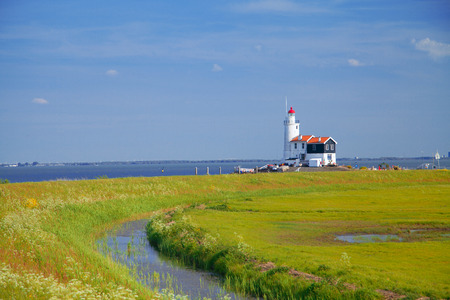 marken: lighthouse in Marken is on the coast of the Sea in Europe