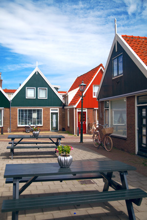 volendam: Vintage Dutch town of Volendam European evening. Retro style. houses and bikes on the street in the summer