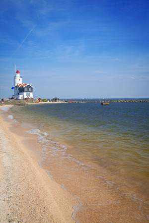 traditionally dutch: lighthouse in Marken is on the coast of the Sea in Europe