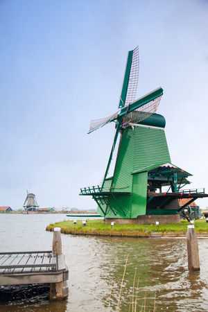 watermanagement: beautiful Dutch windmills in the summer the water. Authentic locations Europe