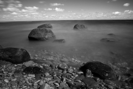 infrared: rocks in the sea. black-and-white photos on a large exposure. infrared photography