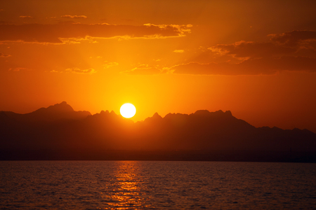 Sunset on the Red Sea mountains in the background. Evening in Africa 写真素材