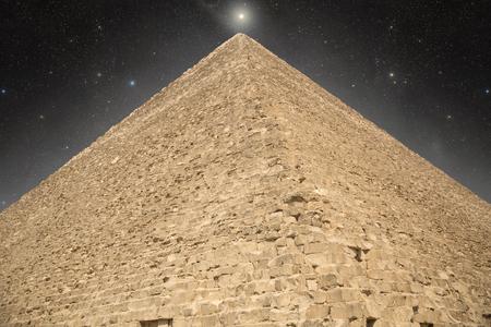 dark skies: Pyramid at night under the stars. shining star Stock Photo