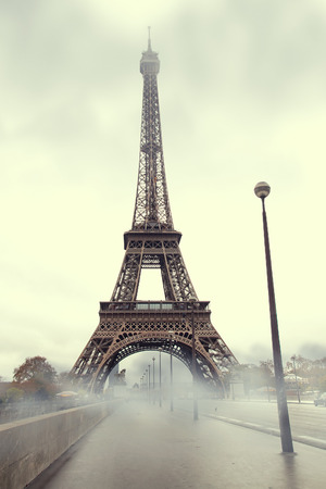 tower house: fog in Paris. Autumn morning at the Eiffel Tower. Stock Photo