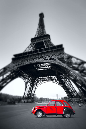 tower: summer sunset vintage red car stands on the Champ de Mars. Eiffel Tower