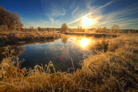 wasatch: Dawn at the river .osen. frost on trees and grass Stock Photo