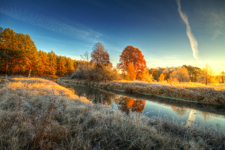 midway: Dawn at the river .osen. frost on trees and grass Stock Photo