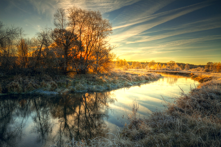 autumn splendor: Dawn at the river .osen. frost on trees and grass Stock Photo