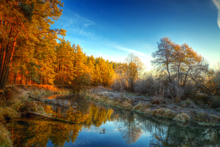 Dawn at the river .osen. frost on trees and grass Stock Photo