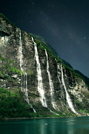 seven sisters: At night, under the light of stars. Geiranger fjord, Norway - waterfalls Seven Sisters. Stock Photo