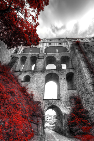 Black and white photo with the color red.  Cesky Krumlov, Czech republic Stock Photo