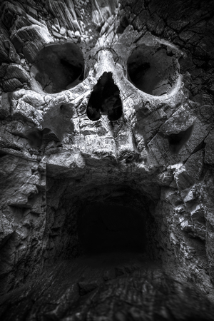 eyes cave: cave in the mountains, a human skull. fantastic picture Stock Photo