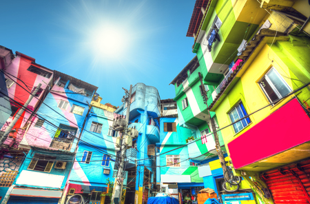 the sun is shining. Colorful painted buildings of Favela  in Rio de Janeiro Brazil