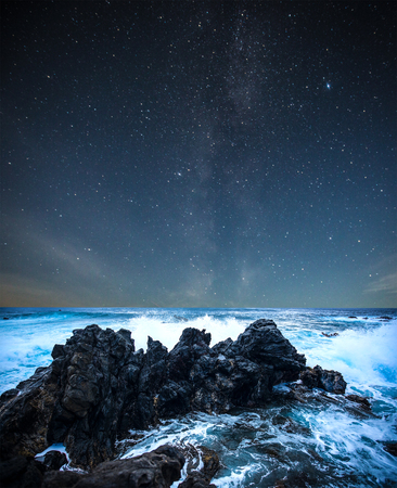 northern spain: stars in the sky over the sea shine at night.
