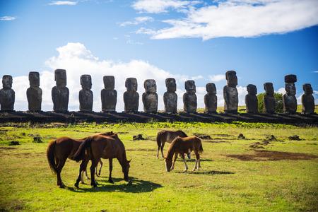 mystic place: Wild horses against Ahu Tongariki. Easter Island Stock Photo