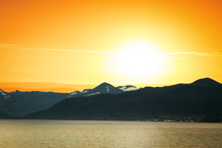 natural phenomenon: fjords dawn. the sun rises over the northern mountains Stock Photo