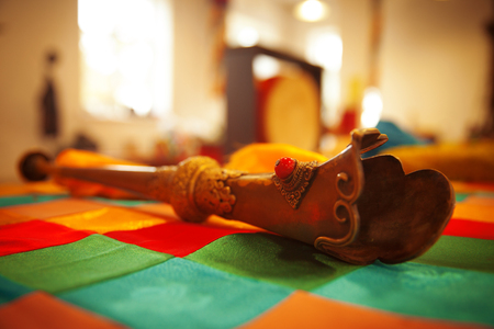 shamanism: Tibetan trumpet rkang-gling. made of human bones. Stock Photo