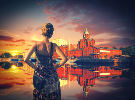 berth: Girl in dress standing on the waterfront.  Helsinki , Finland. Uspenski Cathedral.