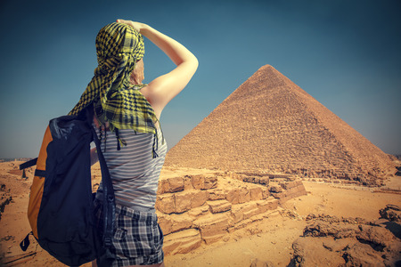 chephren: woman traveler with a backpack and the pyramids at Giza, Cairo. Egypt. Stock Photo