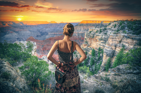 winter park: Girl in dress standing on the waterfront . Grand Canyon National Park seen from Desert View