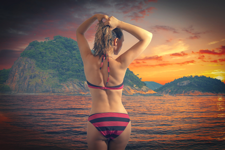 girl in a bathing suit came out of the ocean with wet hair at the beach Copacabana photo
