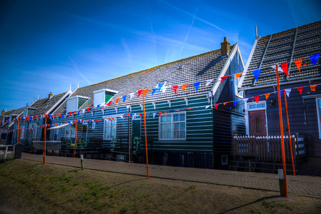marken: Old fishing green cottages on the island of Marken Netherlands Stock Photo