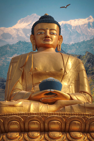 Golden Buddha in Kathmandu on a background of the Himalayas mountains Stock Photo