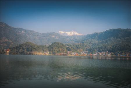 phewa: Lake Phewa - at the second largest lake in Nepal located in the Pokhara Valley near Pokhara and Sarangkot mountain Stock Photo