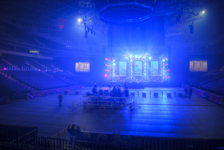 searchlights: stage before the concert shines the beams of searchlights Stock Photo