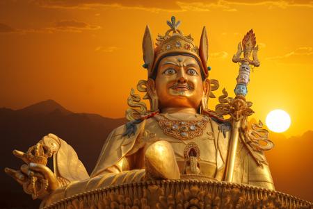 Gold Guru Rinpoche statue stands in Kathmandu. Nepal