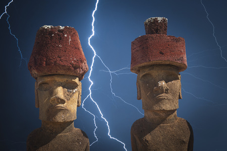 Strong thunder and powerful flashes of lightning.A statue on Easter Island or Rapa Nui in the southeastern Pacific, the territory of Chile. Stock Photo