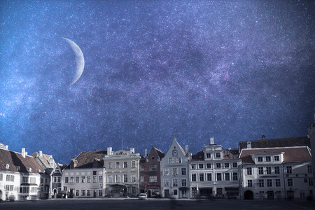 Tallinn - the capital of Estonia, the old city. Astrophotography. Night sky with stars.