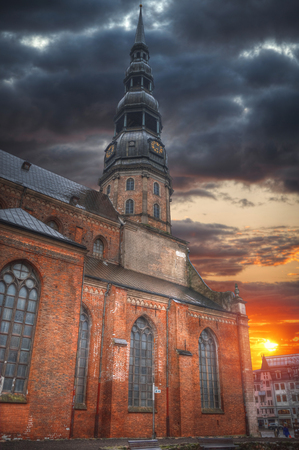 Riga Church of St. Peter and the streets of the ancient city Stock Photo