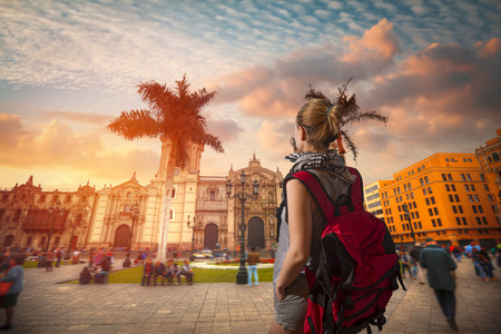 A traveler with a backpack. Panoramic view of Lima main square and cathedral church. 写真素材