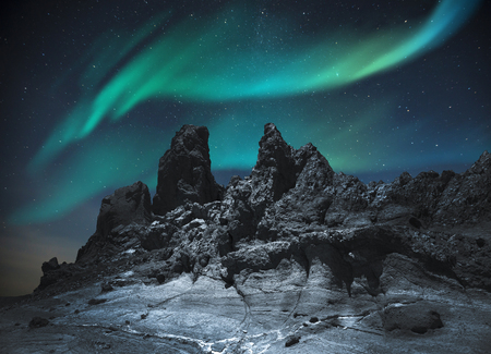 Northern lights in the mountains and plains, at night in the light of stars Stock Photo