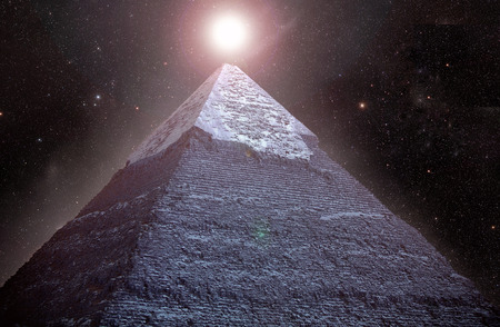 Pyramids of Giza in the background of the starry night sky.  Stock Photo