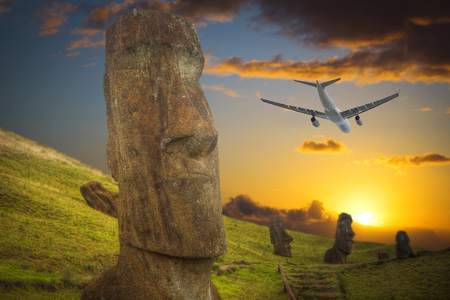 the plane is flying over Moais at Ahu Tongariki (Easter island, Chile)