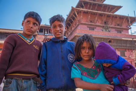 BHAKTAPUR, NEPAL - DECEMBER 14, 2017: Four children in Durbar Square, Kathmandu