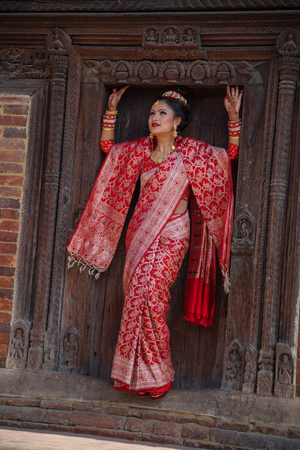 Bhaktapur, Nepal-November 19: A family dress of red color during a traditional wedding in Bhaktapur November 19, 2017.
