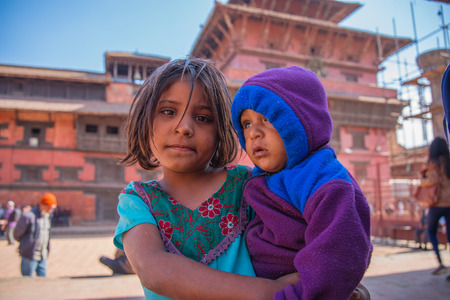 BHAKTAPUR, NEPAL - DECEMBER 14, 2017: Two children in Durbar Square, Kathmandu