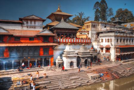 Kathmandu, Nepal - November 22, 2016: The cremation ceremony along the holy Bagmati River in Bhasmeshvar Ghat at Pashupatinath temple in Kathmandu. Redakční