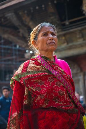BHAKTAPUR, NEPAL - DECEMBER 14, 2017: women from Nepal, in Durbar Square, Kathmandu