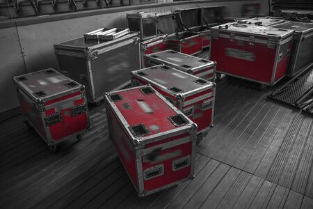 boxes for equipment. preparation for a concert. black and white photography.